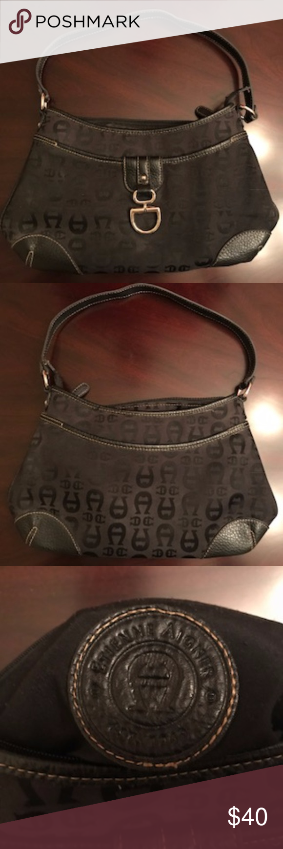 Etienne Aigner Black Purse Black Etienne Aigner purse. Purse is small, but has a middle pocket on the inside. Gently used, in good condition. Etienne Aigner Bags