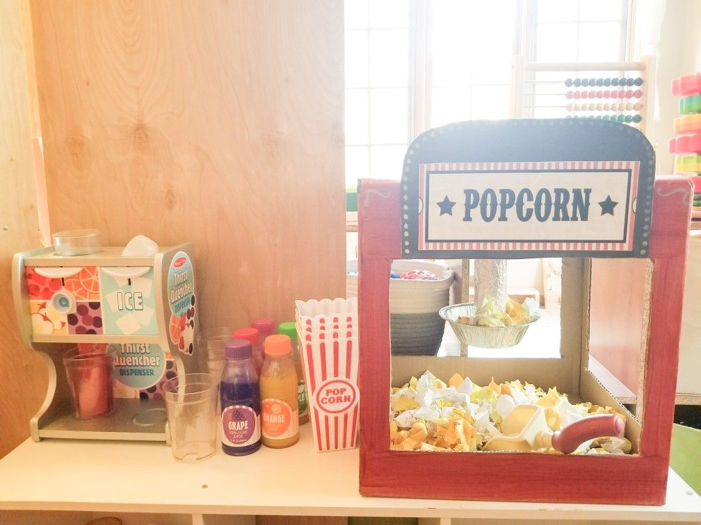 Dramatic Play Area Idea Movie Theater Popcorn Maker Cardboard Box Painted Printable Found Online Fr Dramatic Play Dramatic Play Area Dramatic Play Preschool
