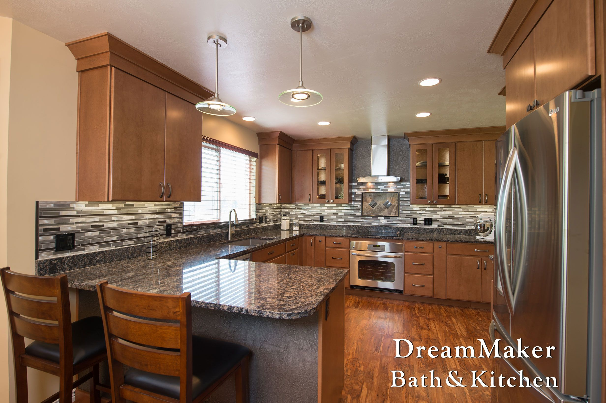 This Awesome Back Splash Ties In Well With The Chrome Appliances.  Photograph By Andrea Hanks Photography.
