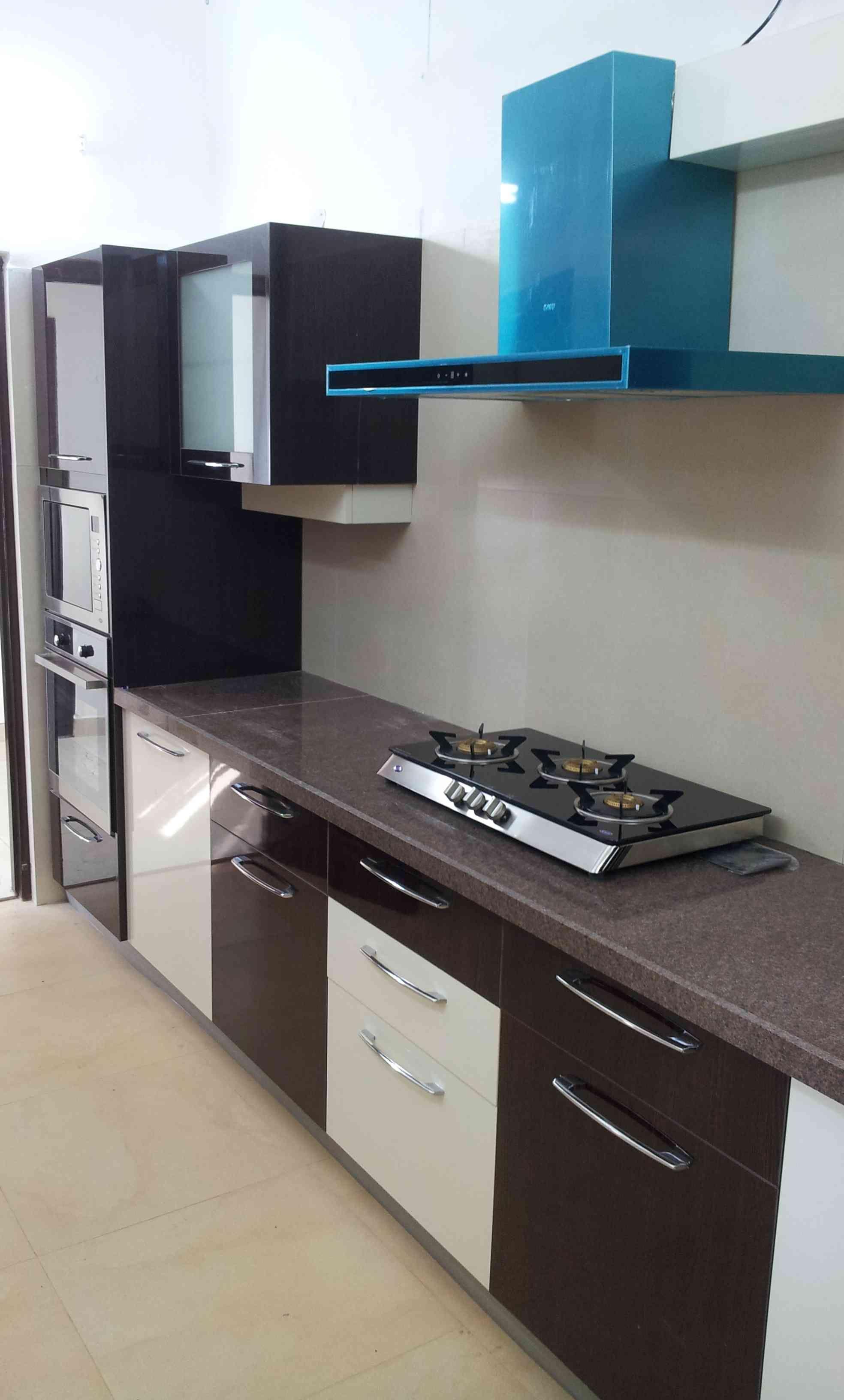 Modular Kitchen, designed by Priyanka Dwivedi.   Kitchen decor ...