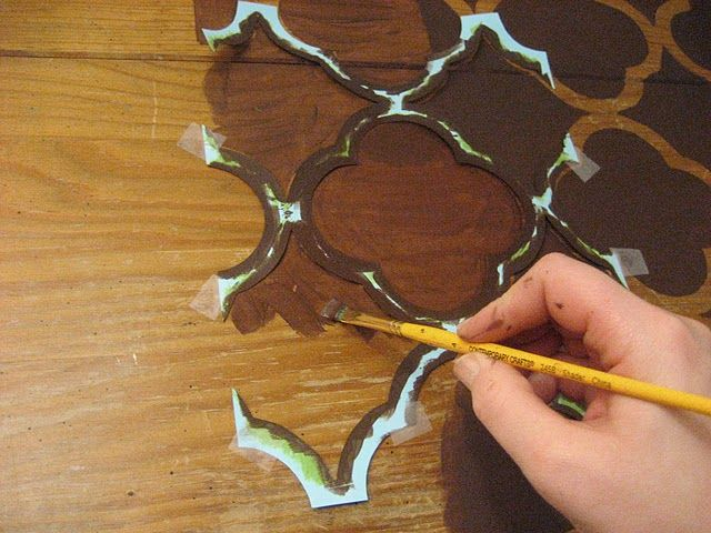 "Quatrefoil painted desktop (stencil) Pinner wrote -- ""Could I do this with stain?""  I wonder about that too --"