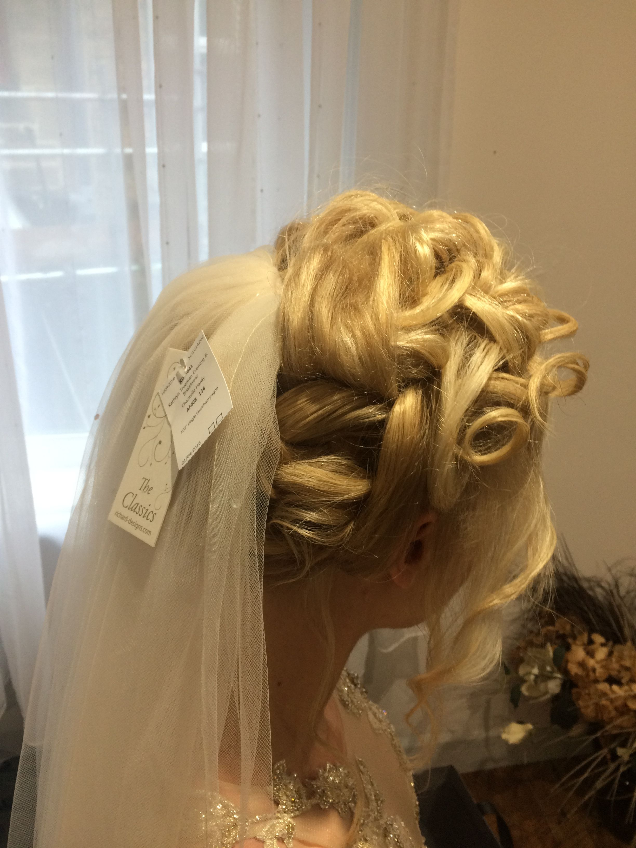 My hair trial with veil in u dress on up do hair with curls