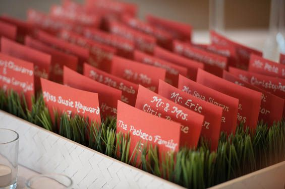 We love this way of showcasing escort cards for a beachside or garden wedding.