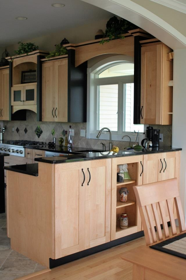 Natural Maple kitchen cabinets with black accent trim ... on Maple Cabinets With Black Granite Countertops  id=35805