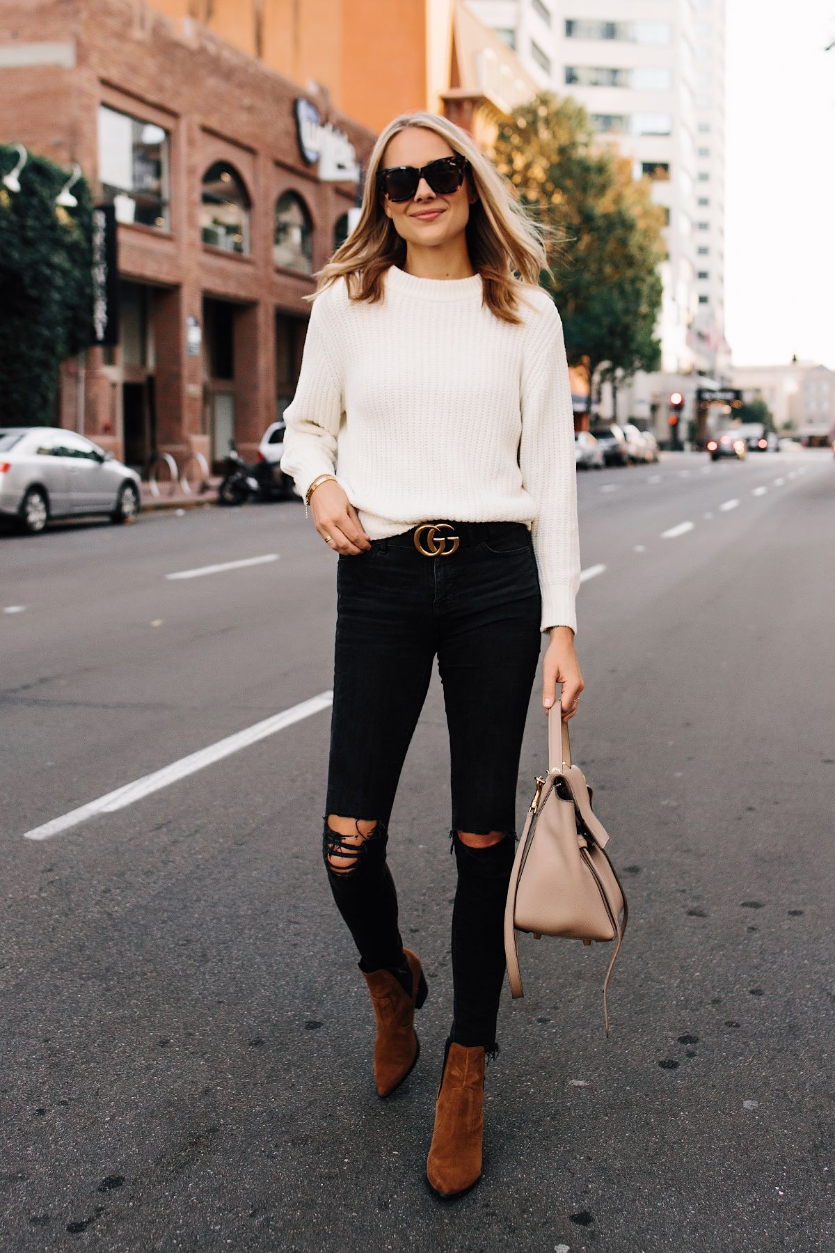 da7a941eeef Blonde Woman Wearing Ivory Knit Sweater Madewell Black Ripped Jeans Gucci  Logo Belt Steve Madden Brown Chelsea Booties Outfit Celine Mini Belt Bag  Fashion ...