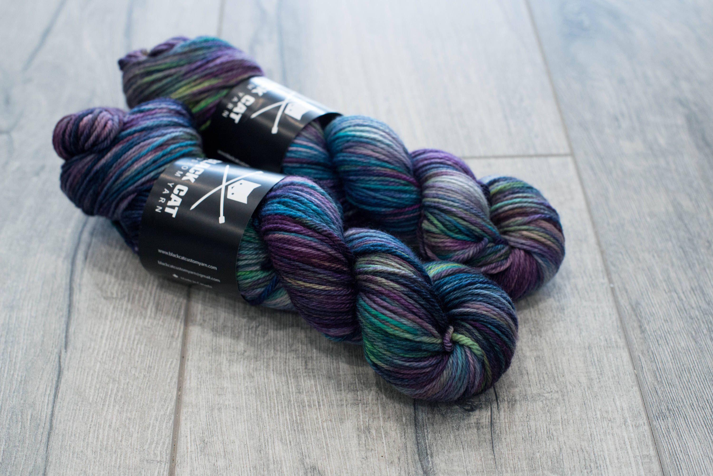 Worsted weight merino yarn 100% Superwash Merino Sweater weight yarn. Medium Weight yarn. Demonhunter. Multicolored purple and green yarn by blackcatcustomyarn on Etsy https://www.etsy.com/listing/568092186/worsted-weight-merino-yarn-100-superwash