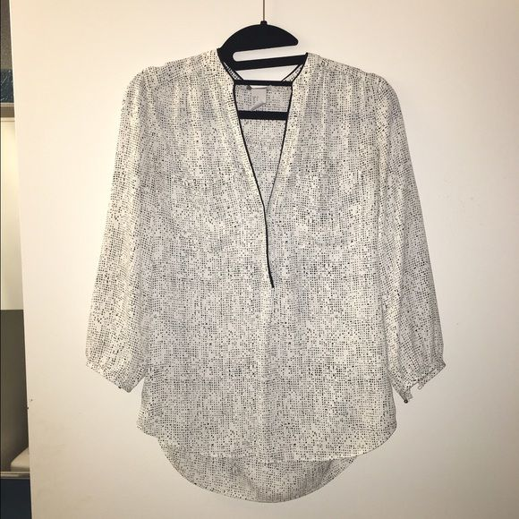 Like new, H&M blouse - size 34 (small/medium) Like new, H&M blouse - size 34 (small/medium). White with black specs. Vneck collar that has a couple buttons on the inside. H&M Tops Blouses