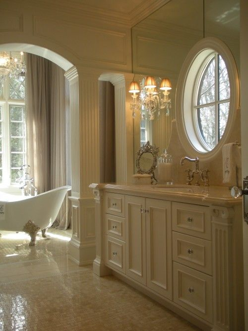 such a luxurious bathroom. Love the windows and the sconces. Such a ...