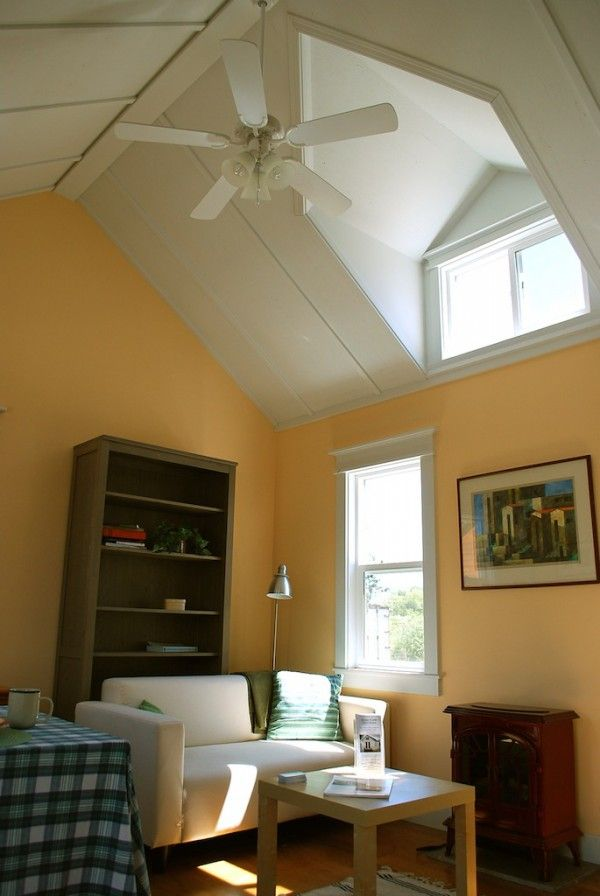 Vaulted ceilings with dormers make the living room feel airy.