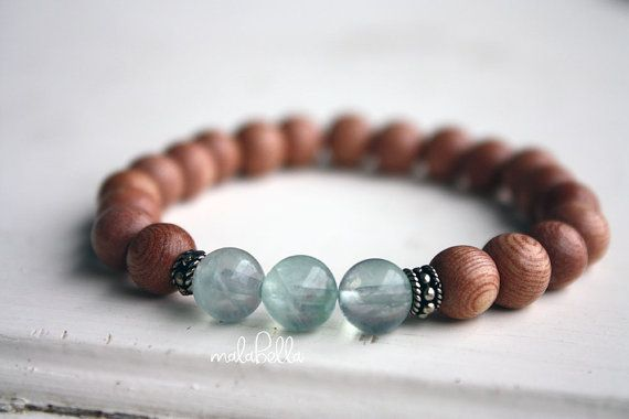 Gentle Waves Mala Bracelet is hand crafted with love and care using 8mm Rosewood and Green Fluorite .925 Sterling Silver accents.