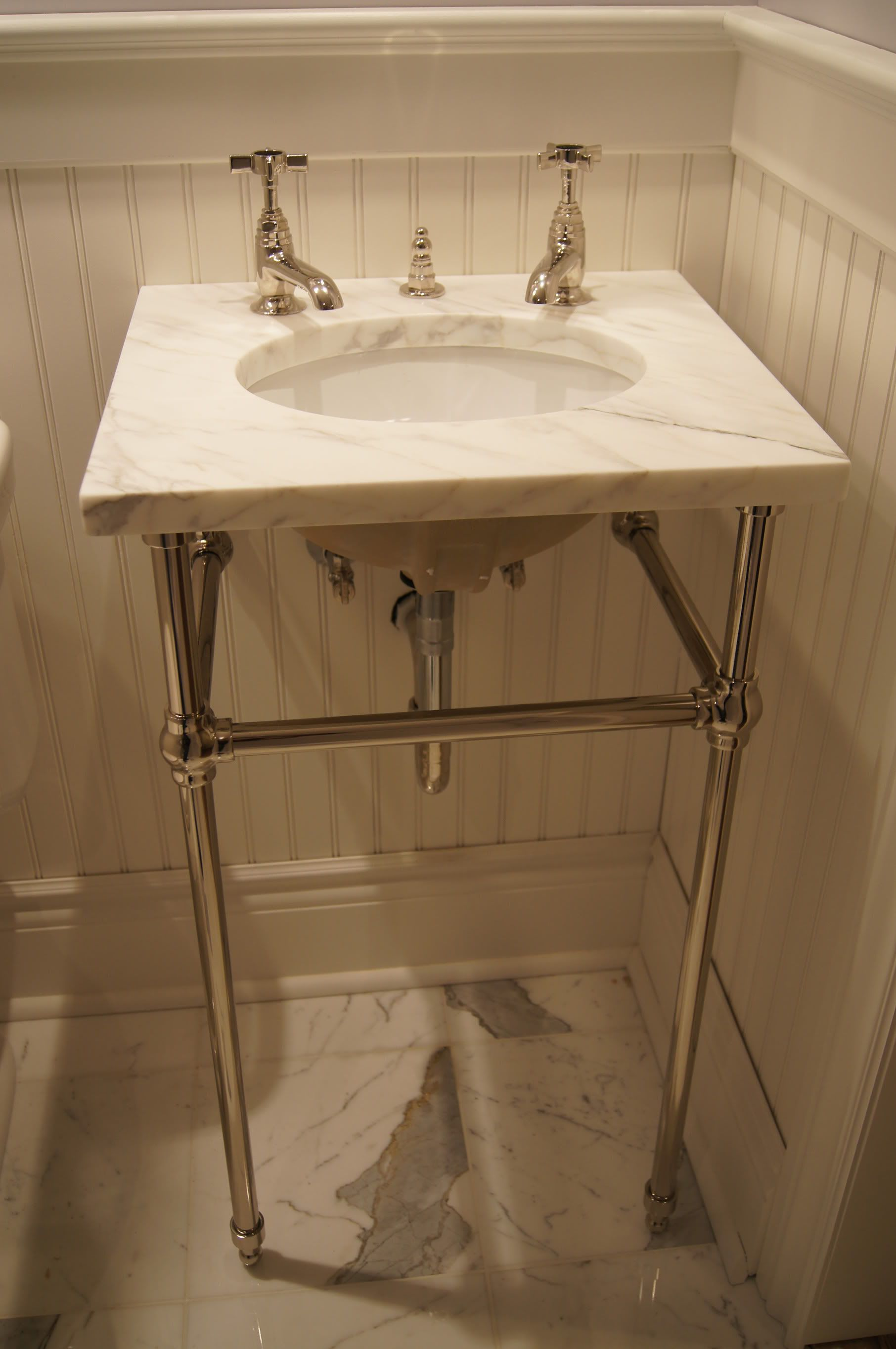 Undermount sink with a marble top on console legs for Best bathroom vanities for small bathrooms