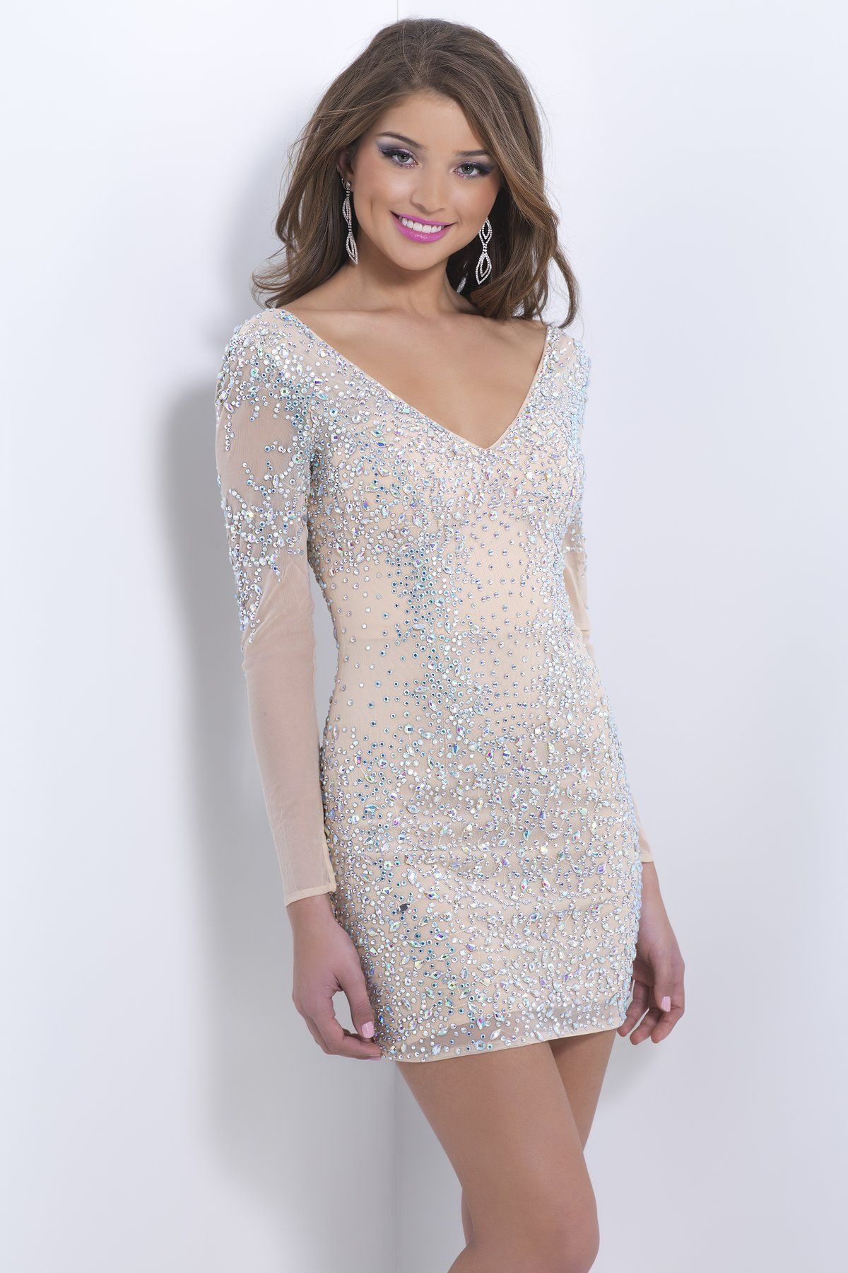 Jeweled miniature crystals drape your nude-silhouette in this long-sleeve open-back sexy dance dress.