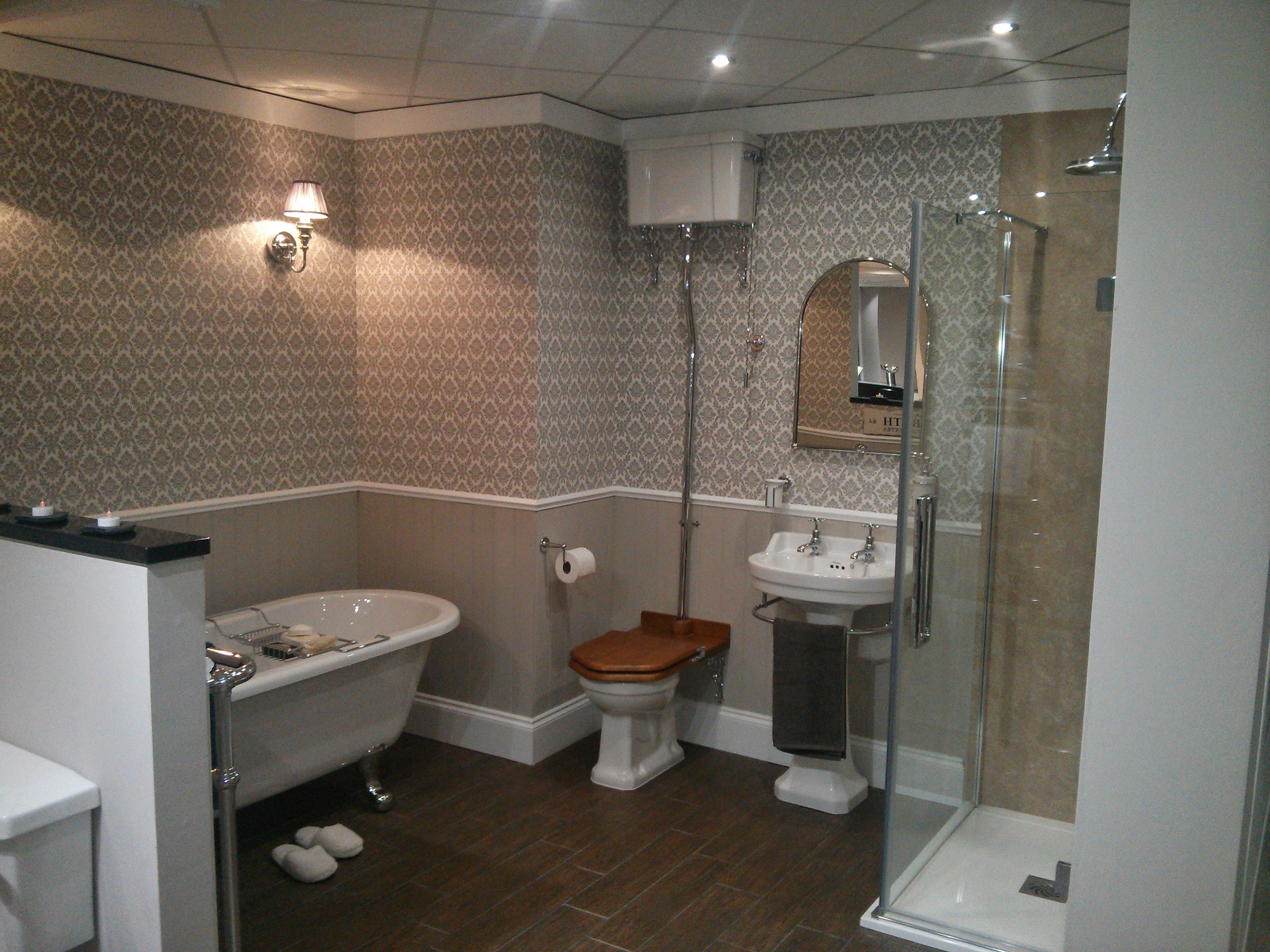 Country bathroom with high level traditional toilet  tongue and grove  panelling used as an alternative. Country bathroom with high level traditional toilet  tongue and