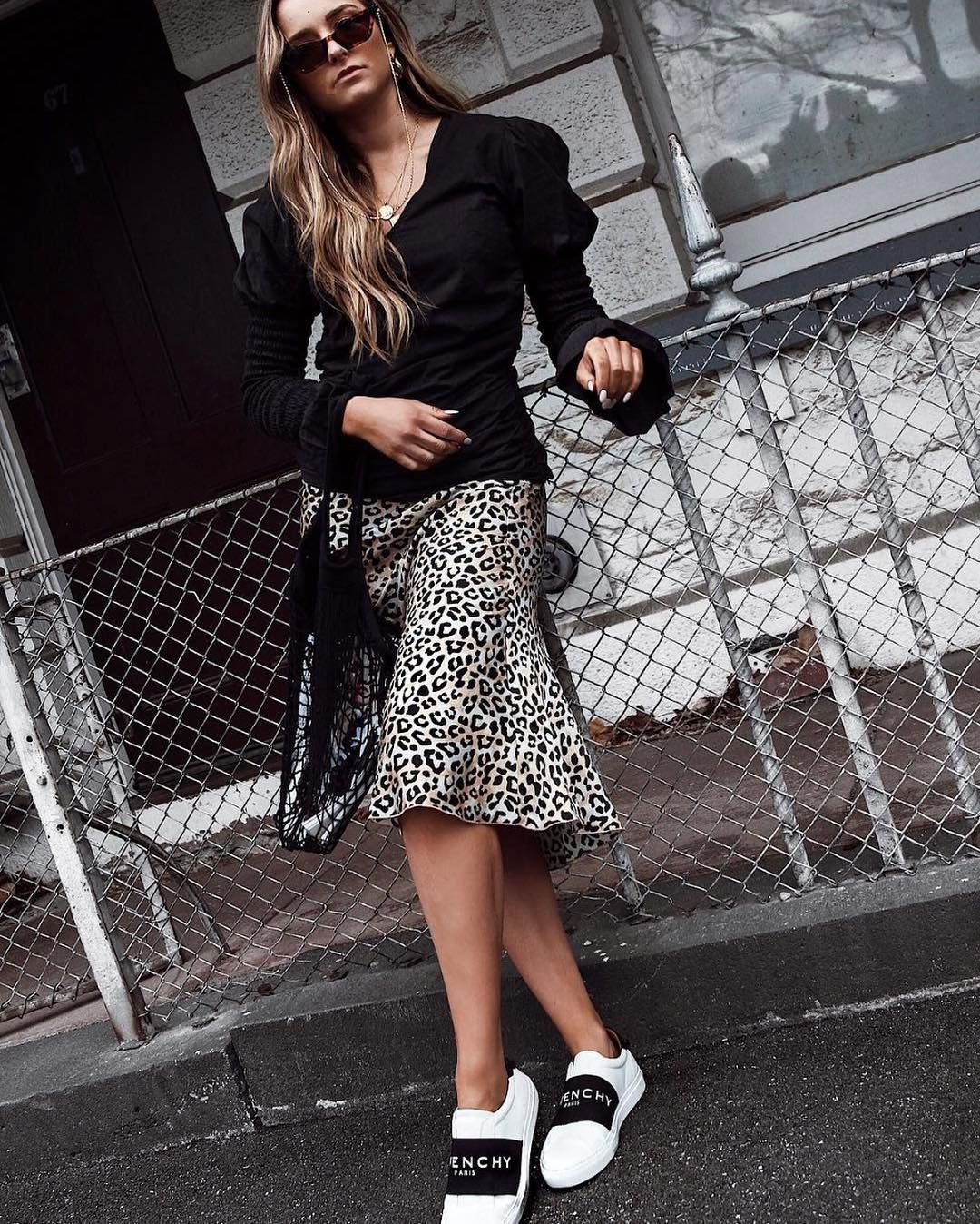 ffd6f492c006 The Ellie Midi Skirt by Chosen in Leopard is a silk midi skirt with fluid  hem, cut from the finest silk. A feminine go-to piece to take you from day  to ...