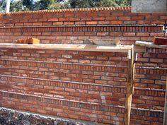 Fotografía de Muro aparente de tabique de barro rojo por Arquitectura Y Construcciòn #26124.