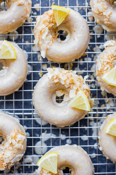 Baked Vegan Lemon Coconut Donuts: Super soft moist and flavorful baked vegan donuts with a spring flair! So simple to make and only requires a handful of ingredients. The perfect healthier sweet treat for spring and summer!    fooduzzi.com recipe #donuts #vegandonut #vegandessert #bakeddonuts
