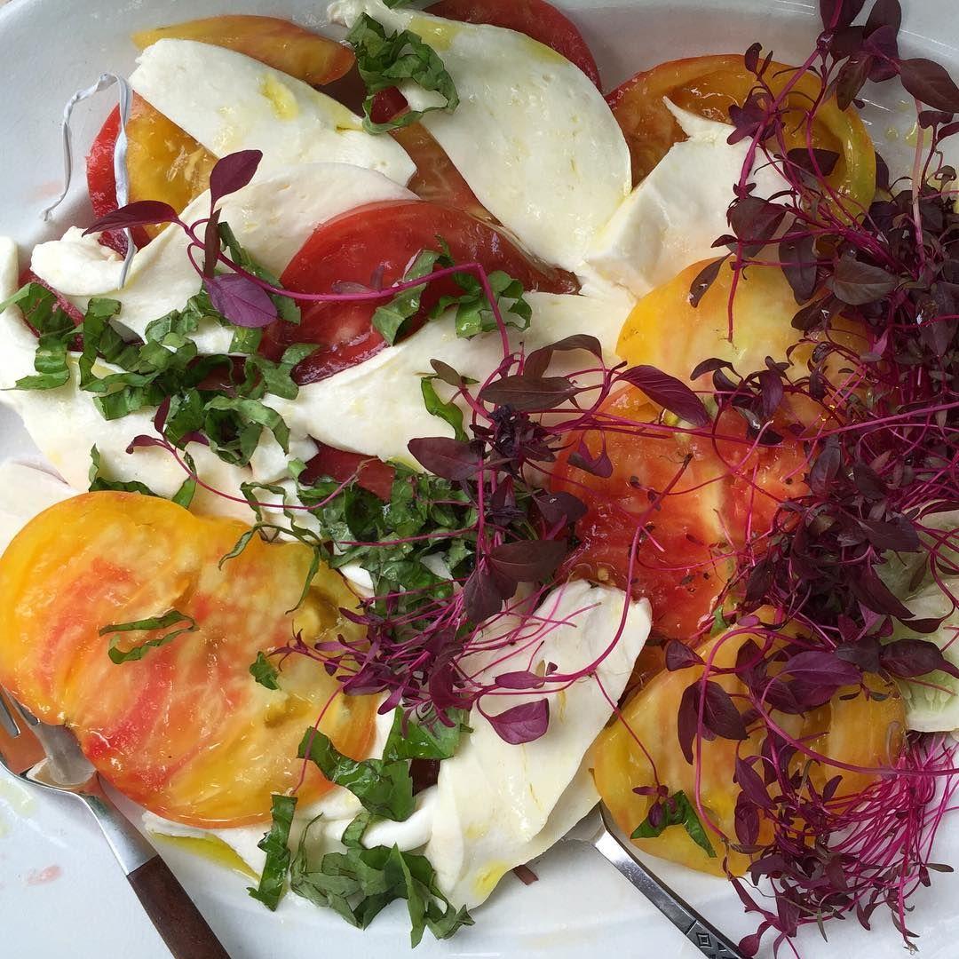 Heirloom tomatoes, homemade mozz, amaranth sprouts. #sundayfunday #bestsaladever #lovefarmersmarkets