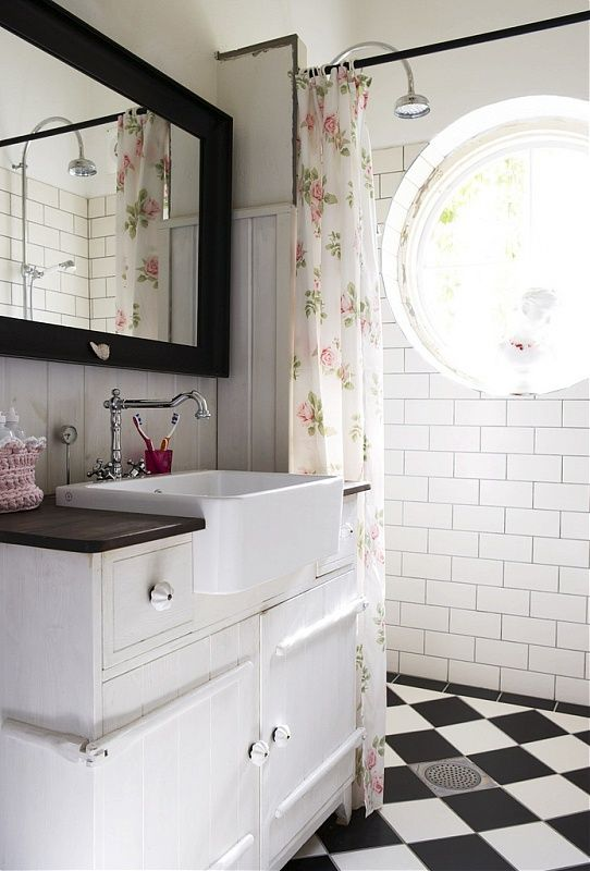 LOve the black & white floor, subway tile, and the farmhouse sink! Great combo:)