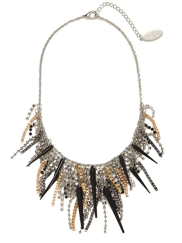 Delight in the wicked allure of this statement necklace. With its lush fringe of spikes, chain links and beads, its wonderfully eclectic and rock-and-roll chic. This is part of the Designer Series: Adia Kibur
