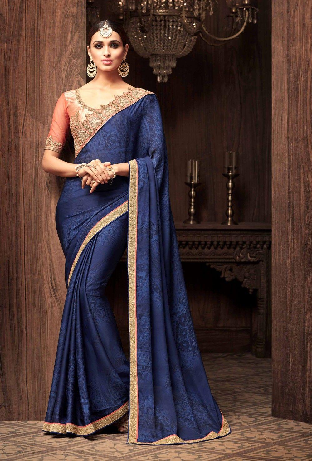 60a80c19114a9 Blue designer saree with contrast peach blouse