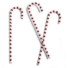 How can I make these???  Find some cheap & small shephard's hooks, spray paint white, then wrap red electrical tape...maybe?
