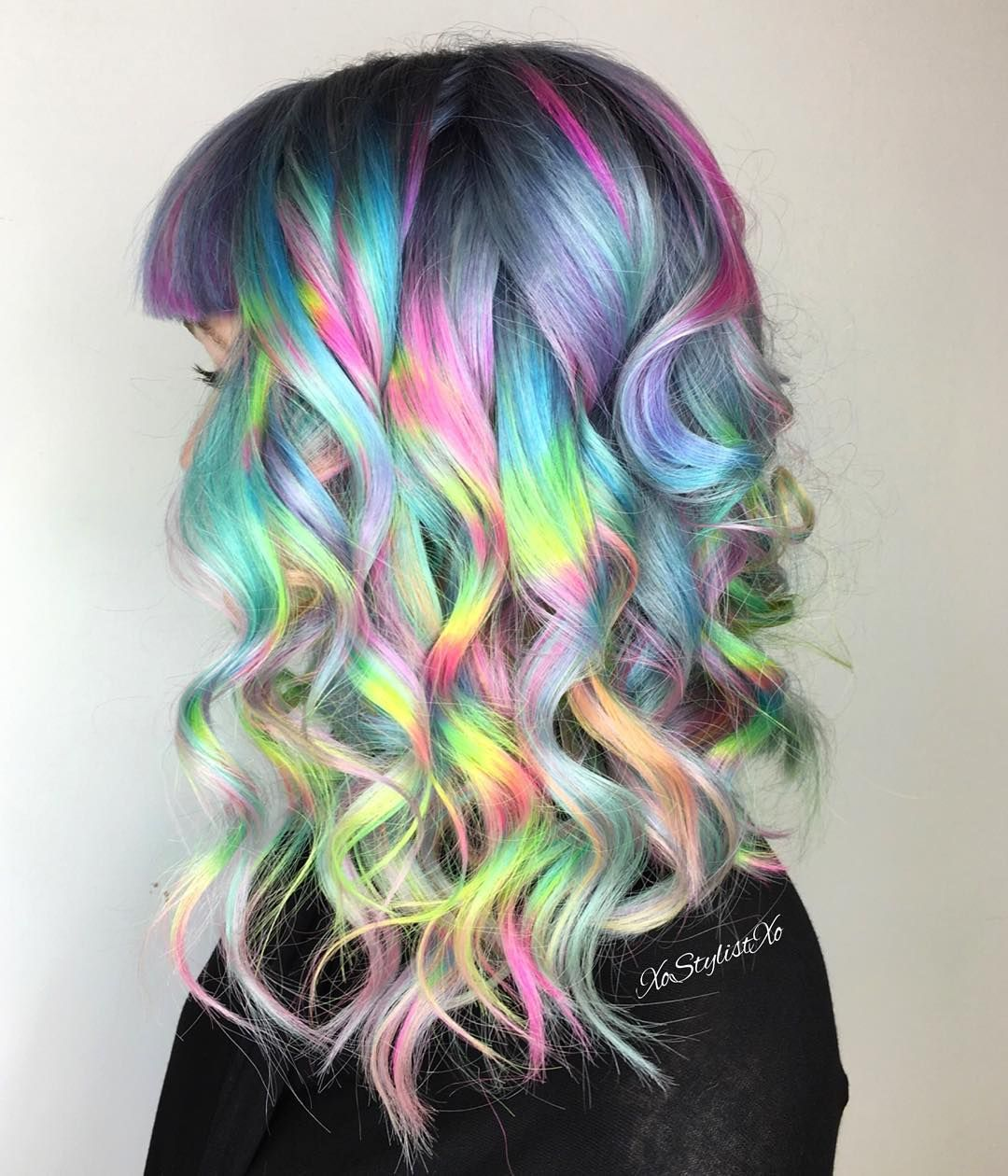 """Hair by @xostylistxo: """"Hologramic Hair series with my signature #hairfeathers."""""""