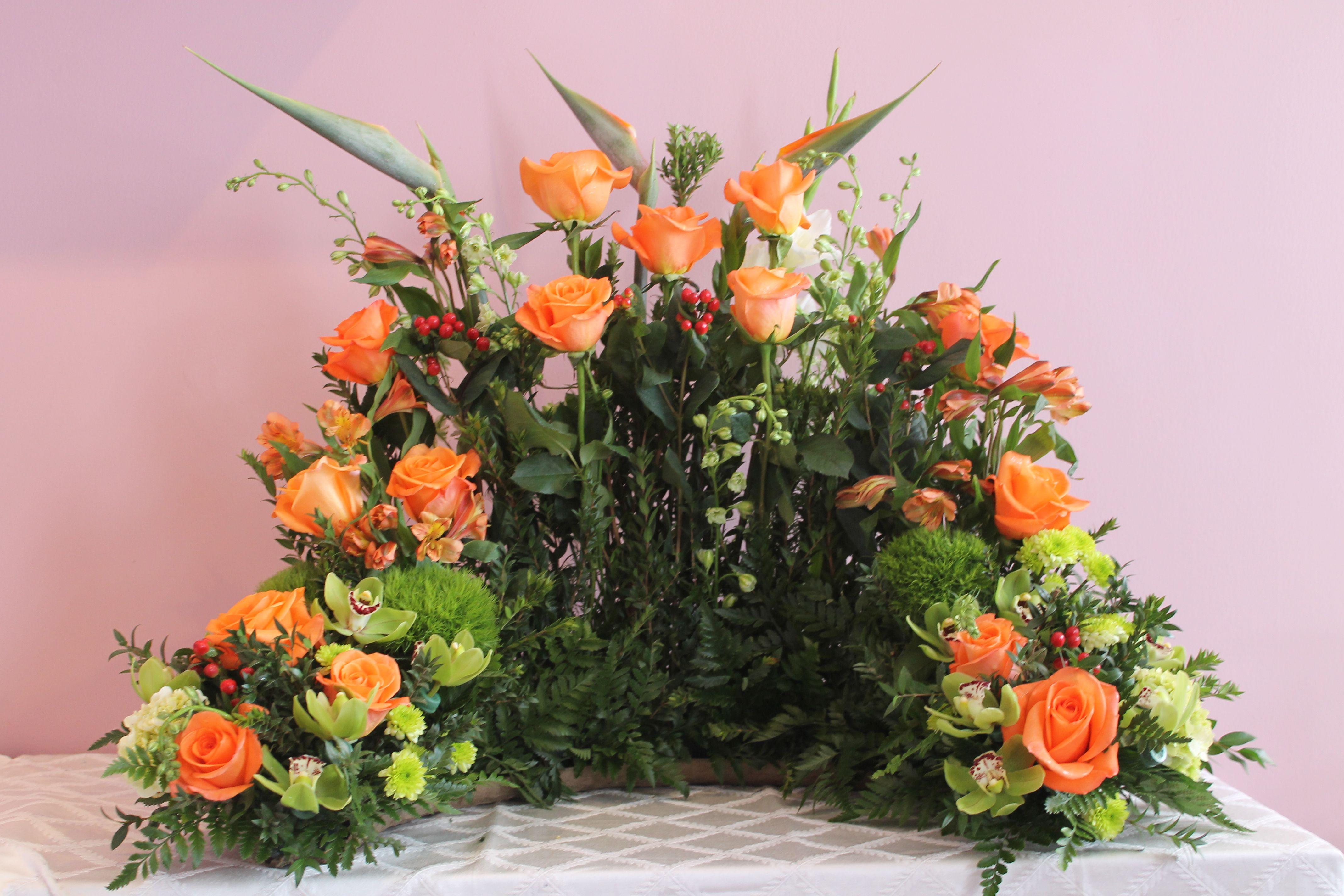 All Orange Urn Arrangement created at Harbourview Flowers in Thunder Bay ON
