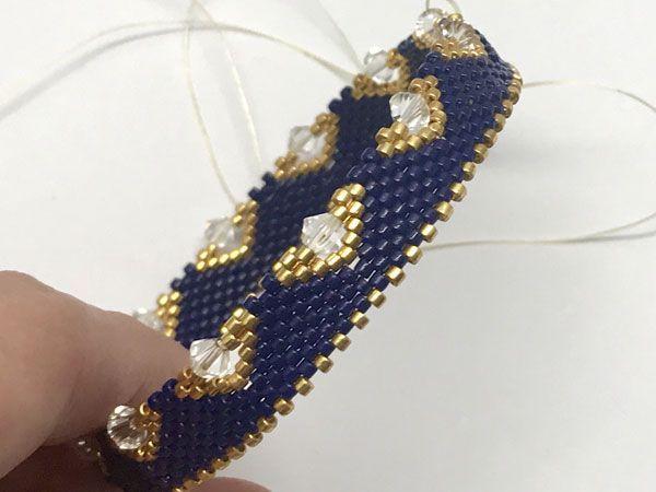 DIY peyote bracelet made of braided bracelet with Miyuki Delicas beads