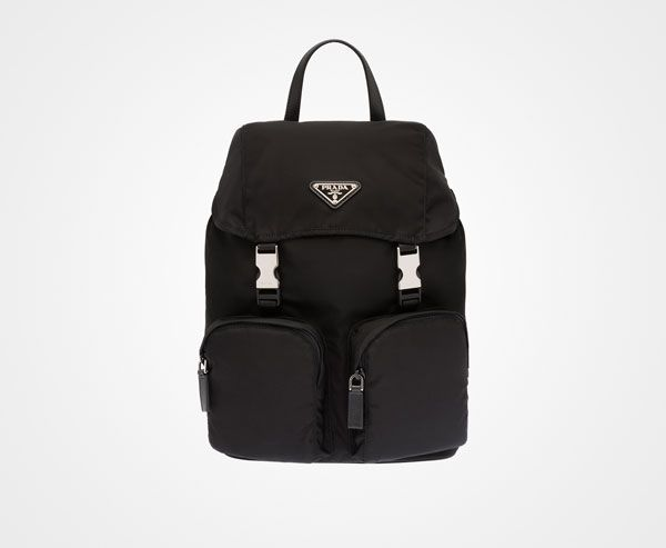 Fabric backpack Single leather handle Adjustable fabric harness straps  Steel hardware Enamel triangle logo Top flap with two side release.