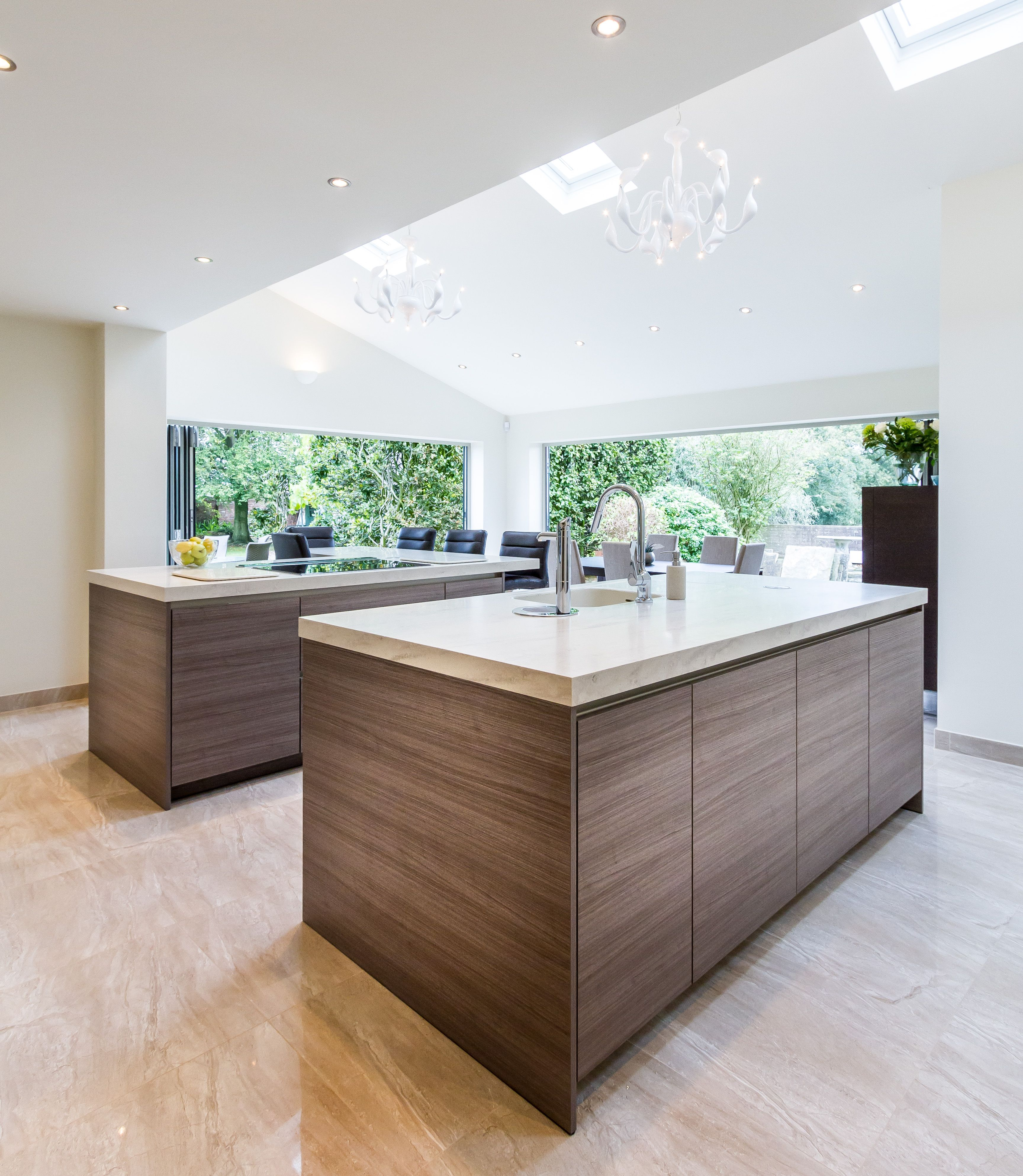 Two Sets Of Bi Folding Doors Compliments The Two Islands New Kitchen Kitchen Extension Bifold Doors