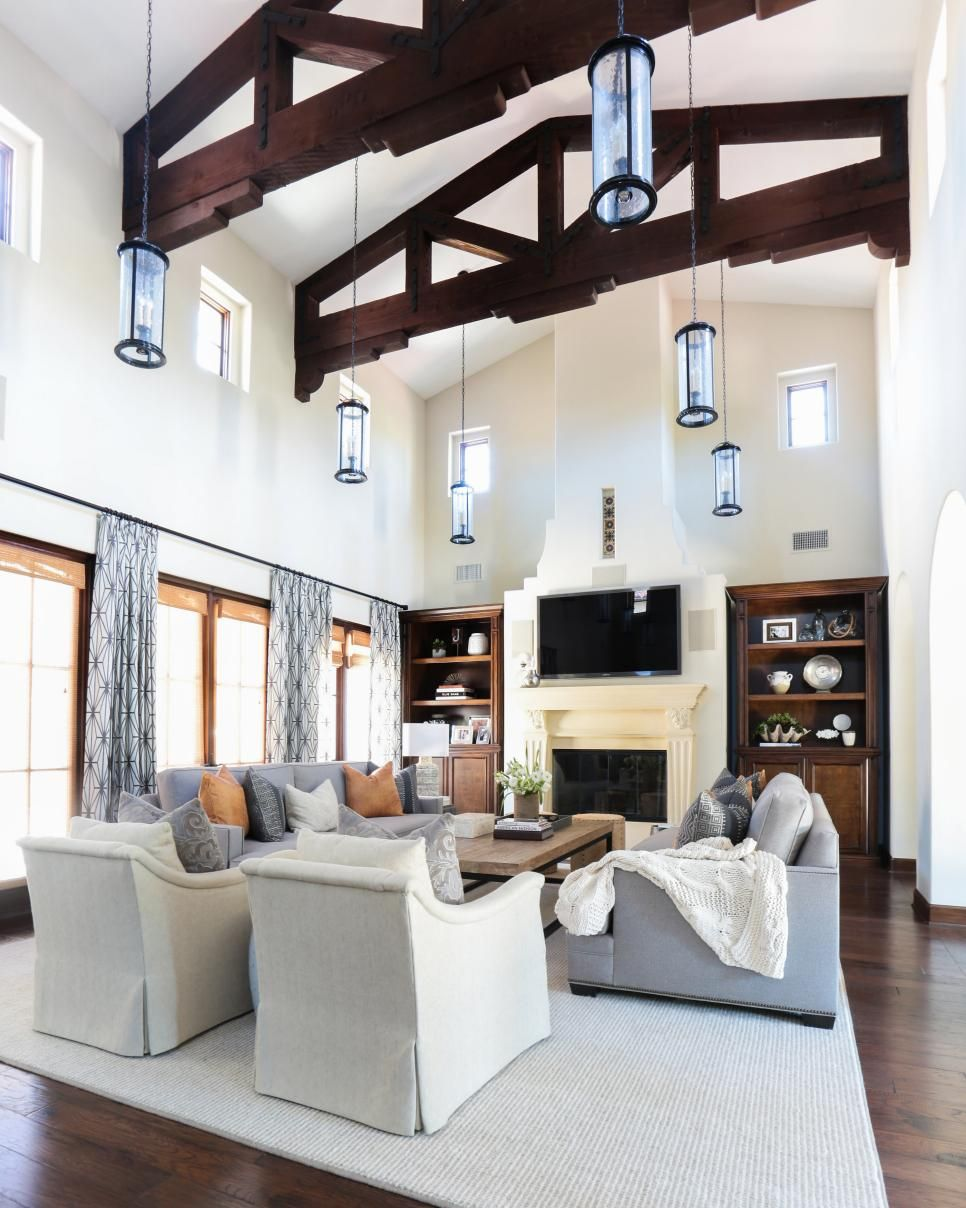 These Transitional Living And Dining Spaces Feature A Blend Of Spanish Modern An Spanish Living Room Transitional Living Room Design Transitional Living Rooms Concept transitional family room