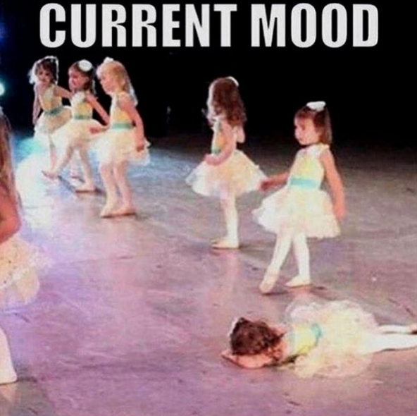 girls doing ballet performance, one girl is lying facedown on stage. caption current mood