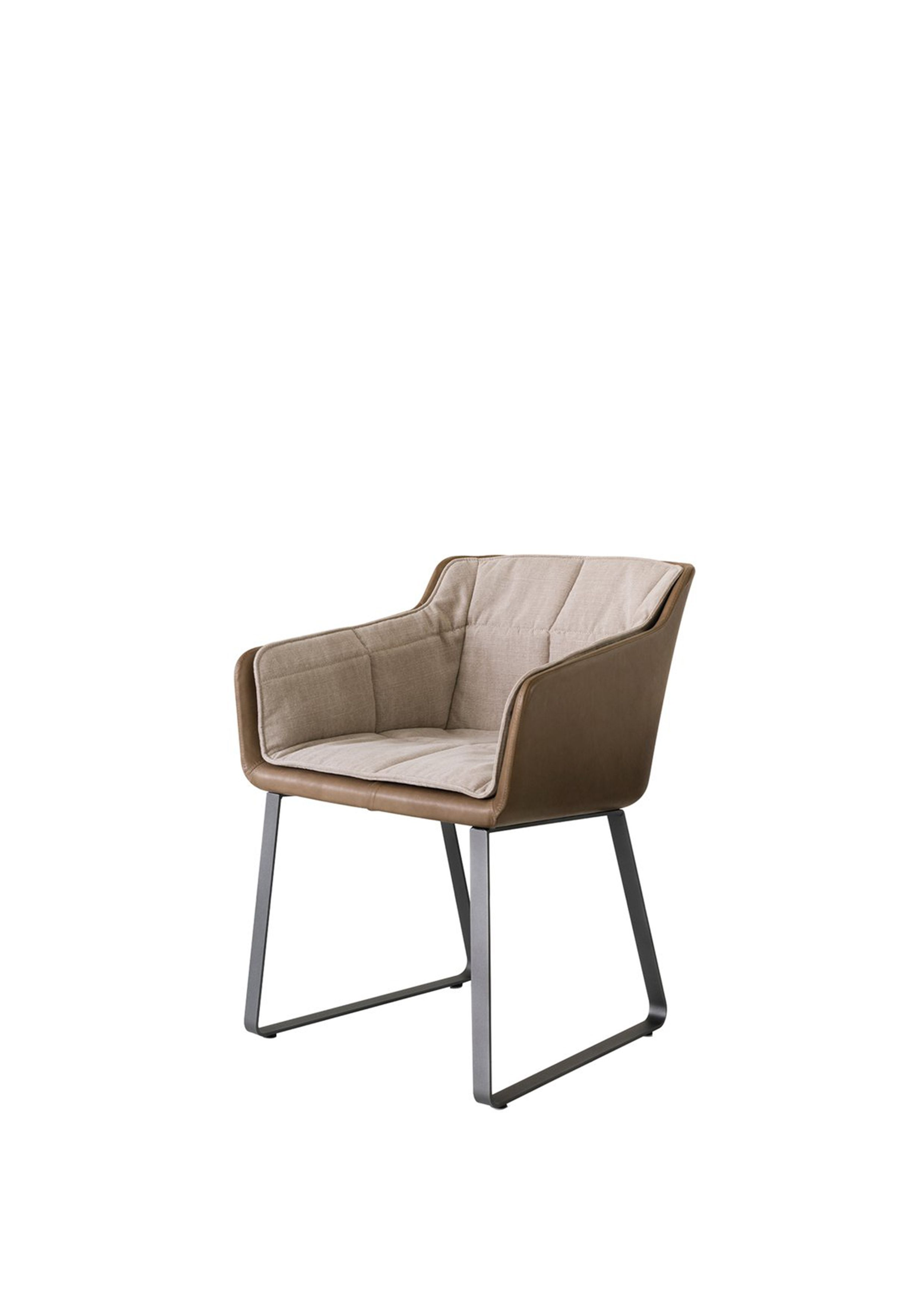 comfy chair. An elegant, curved shell, realized using