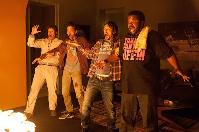 From l to r: Seth Rogen, Jay Baruchel, James Franco, and Craig Robinson in THIS IS THE END (2013)