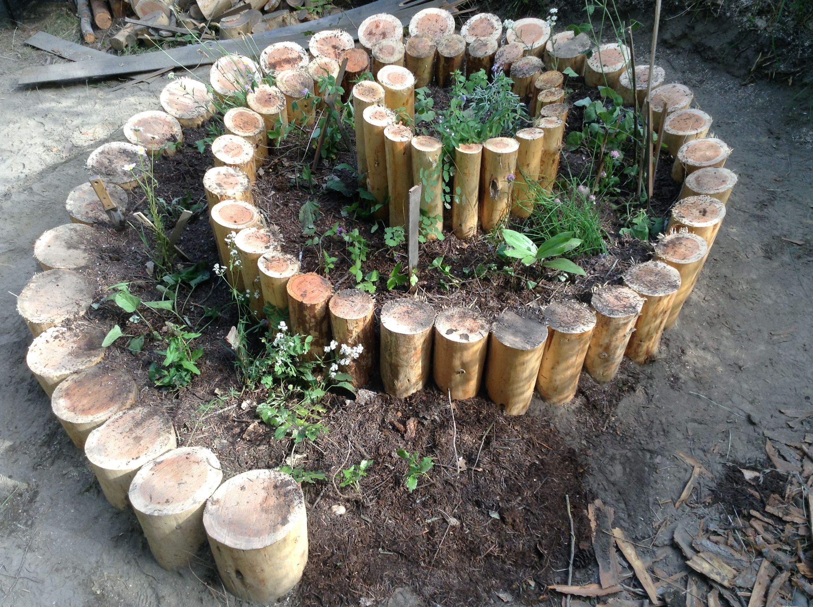 herb spirals log effect by sacred ecology design rmaculture