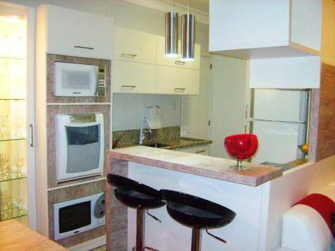 Cozinha americana de um apartamento, de 71 m², em Santa Catarina. Projeto de Vanessa Galina Grosbelli.