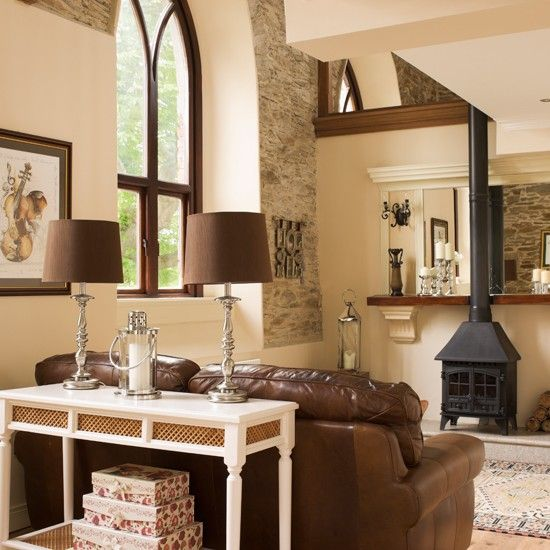 Cream country living room with stove country living for Brown and cream living room ideas
