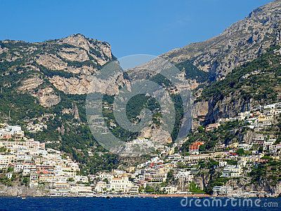 Views of the beautiful Amalfi Coast of the Mediterranean Sea in Italy. Charming towns of white washed buildings, lovely churches and stone castles line the mountainous terrain.