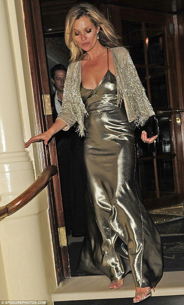 fdb349ed7b70 Golden girl: It would seem Kate Moss was all partied out as she left her  star-studded Topshop launch dinner at London's The Connaught Hotel .