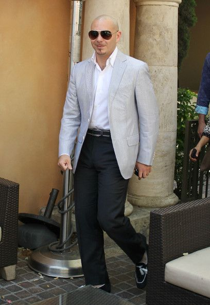 Pitbull Photos Photos Pitbull Arrives At The Grove For An Extra Interview With Mario Lopez Style Pitbull