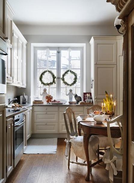 kitchen - beautiful wide plank floors, cream cabinets
