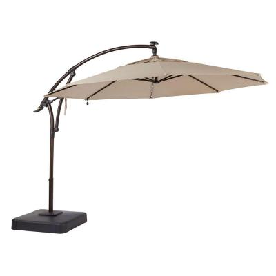 Hampton Bay 11 Ft Led Round Offset Outdoor Patio Umbrella In Sunbrella Sand Yjaf052 A The Home Depot Cantilever Patio Umbrella Patio Umbrella Outdoor Patio Umbrellas