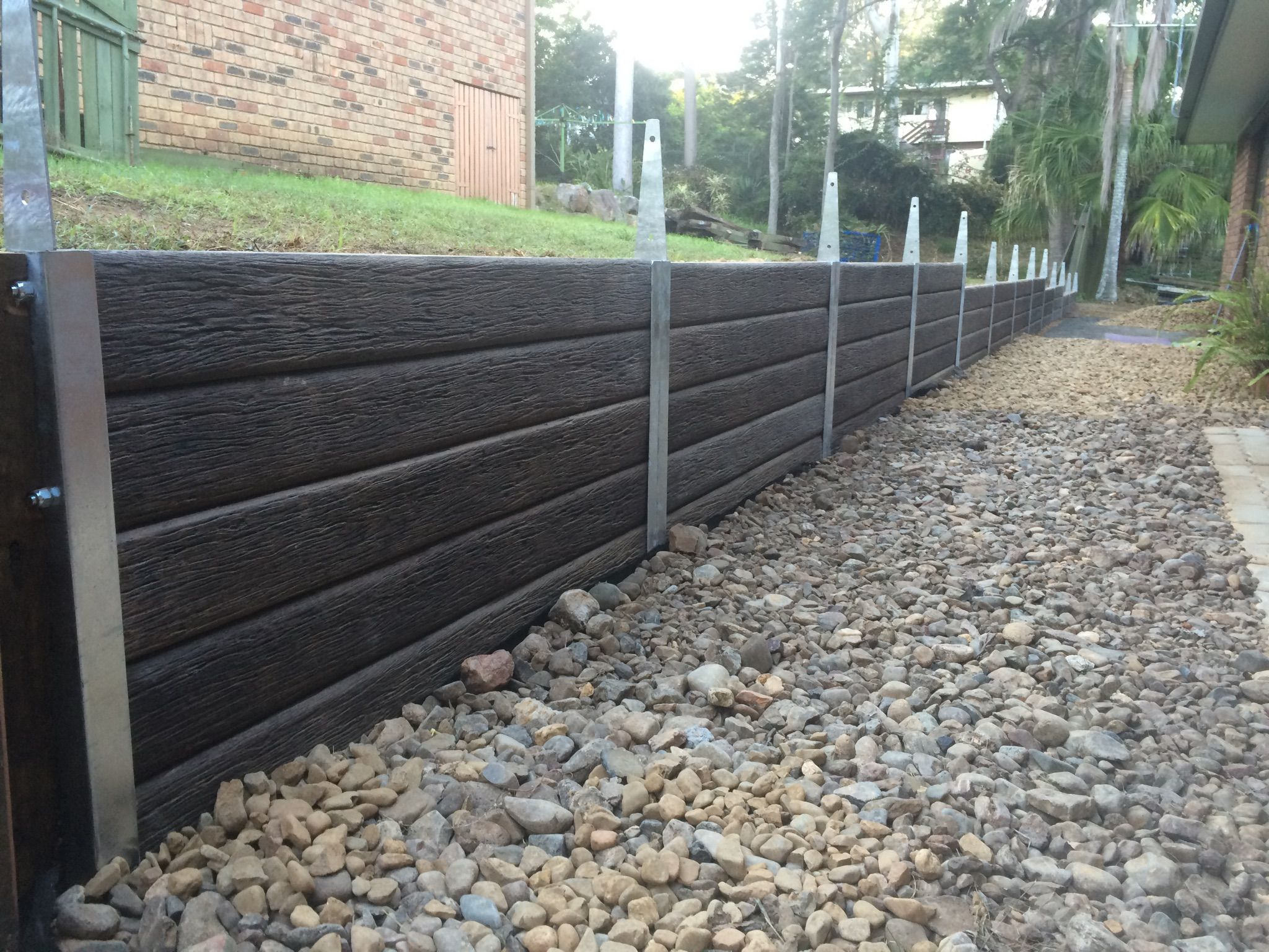 Ridgi Timber Look Concrete Sleeper Steel Gal Post Retaining Walls By Aussie Concre Landscaping Retaining Walls Inexpensive Retaining Wall Ideas Sloped Garden
