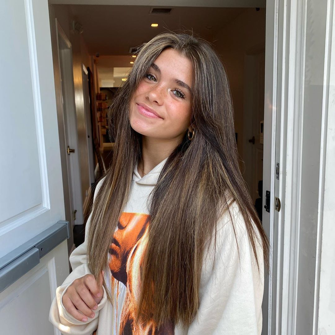 20 Types Of Brown Hair To Consider For Summer If You Don T Want To Go Blonde Long Hair With Bangs Light Brunette Hair Layered Haircuts With Bangs