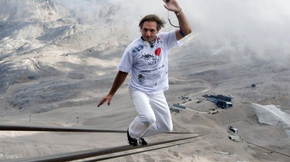 In order to set the world record for highest tightrope walk ever, a Swiss stuntman named Freddy Nock decided to scale Bavaria's 9,000 foot tall Zugspitze mountain by tightrope walking the mountain's 1,000 meter long cable car wire. If that's not impressive enough, he did it all without a balancing pole or harness.