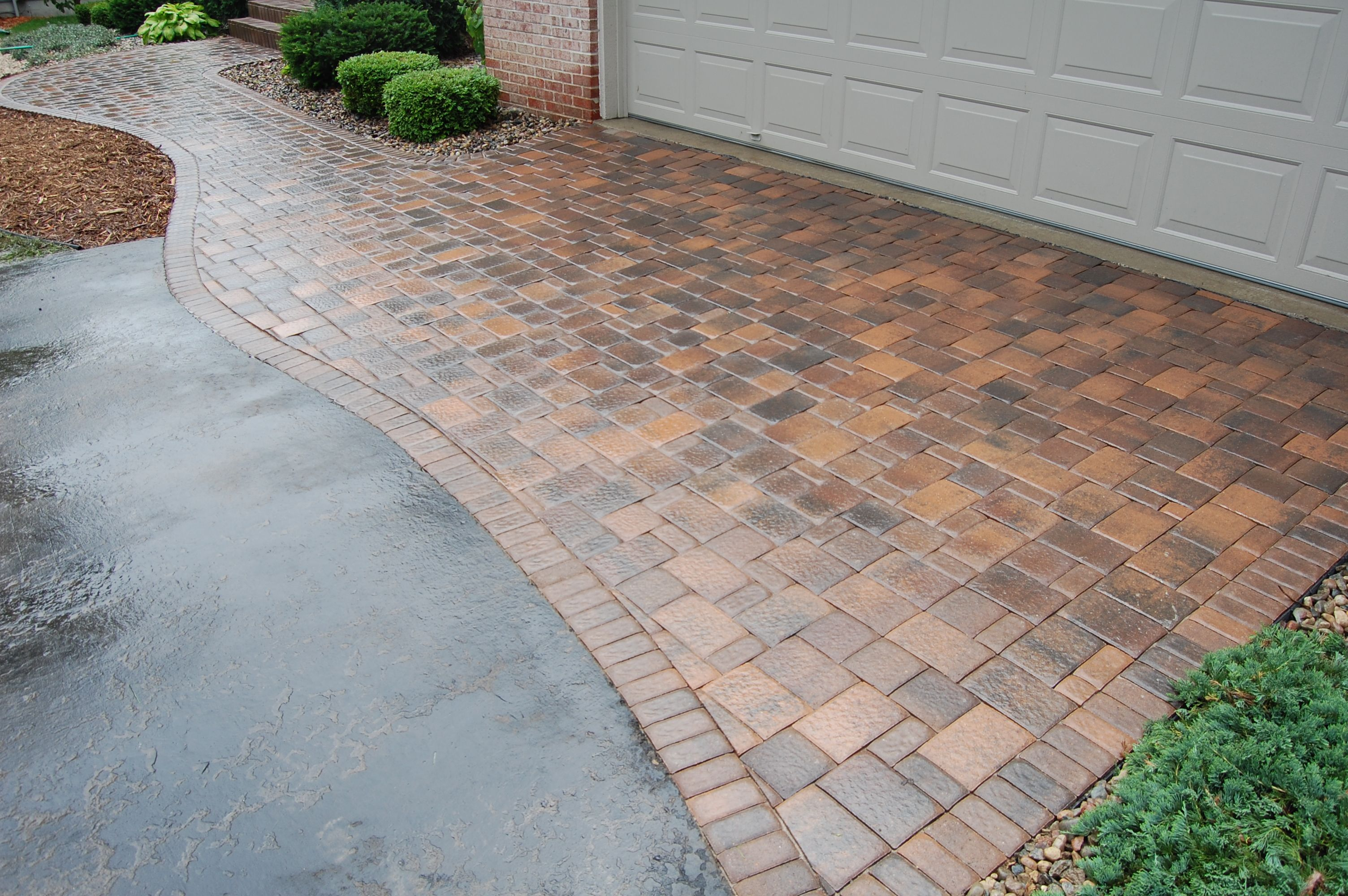 Asphalt driveway connected to brick paver patio google for Driveway apron ideas