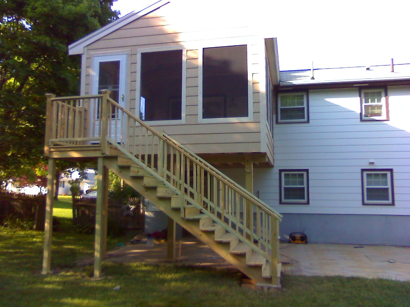 second story screened room with outside stair decks