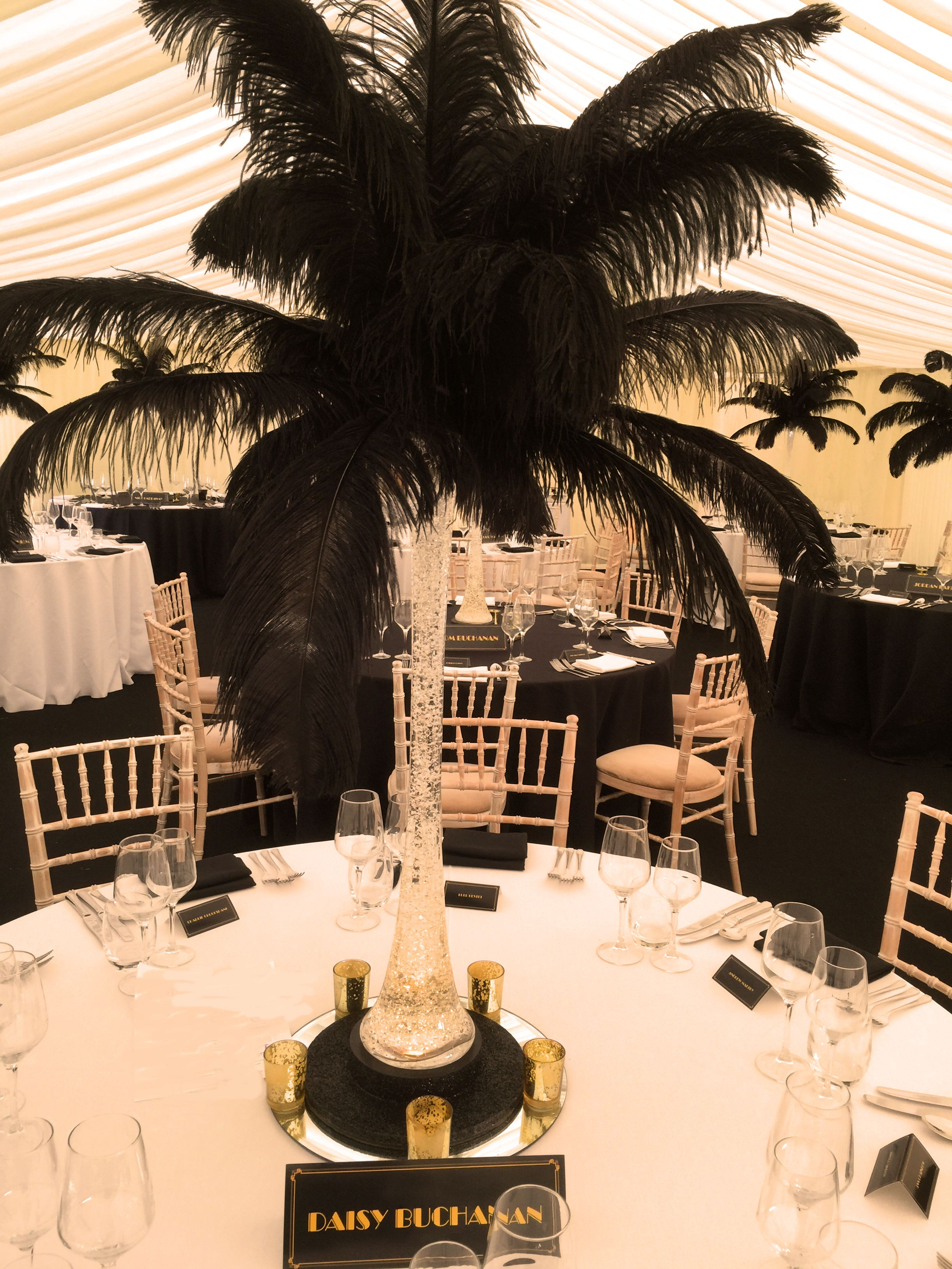 Our feather centrepieces for a black and gold great