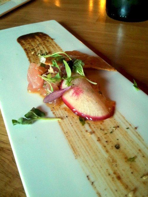 Amuse Bouche  Asian-inspired dish w/ Salmon Sashimi  Fresh Herbs