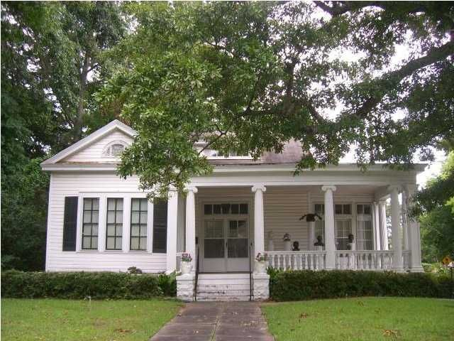 Love how the ionic columns dress up what is a small - Southern homes and gardens montgomery al ...